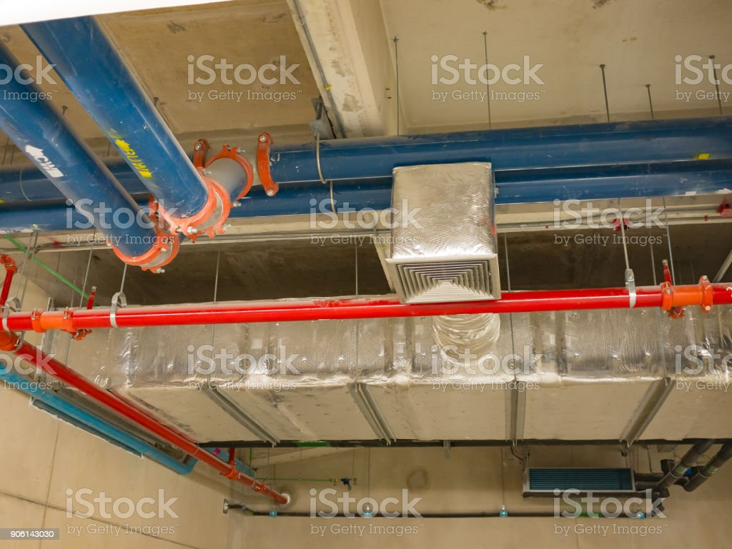 open ceiling under construction. many pipes on ceiling stock photo