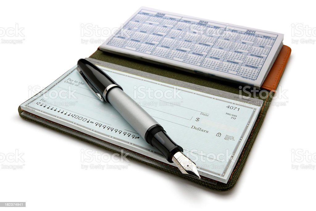 Open checkbook and fountain pen on white background stock photo