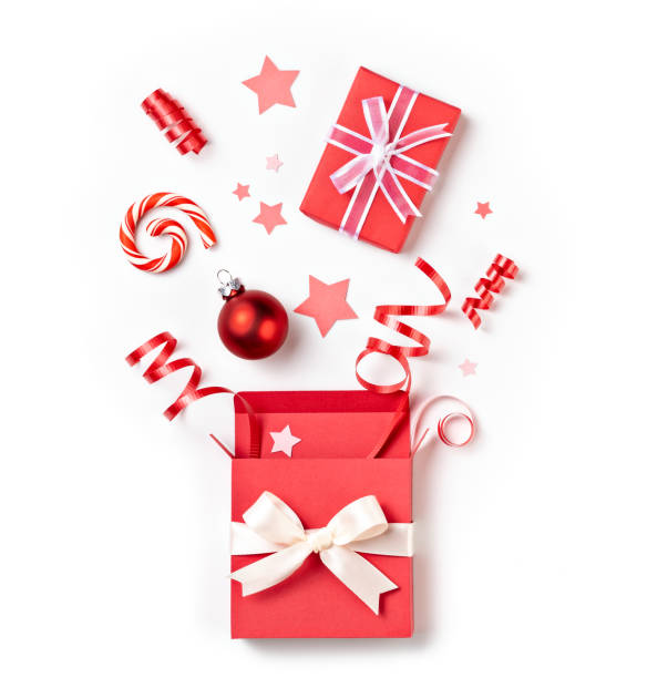 Open Christmas surprise red gift box over white stock photo