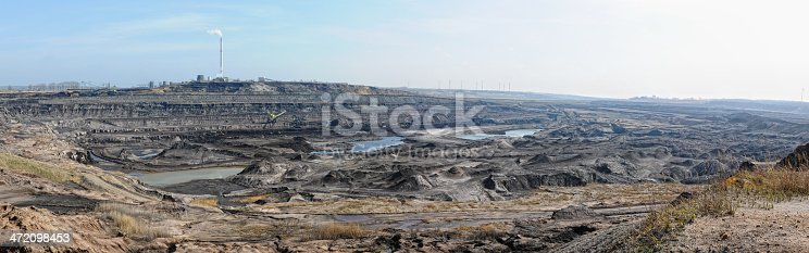 istock open Coal mine with  air pollution 472098453