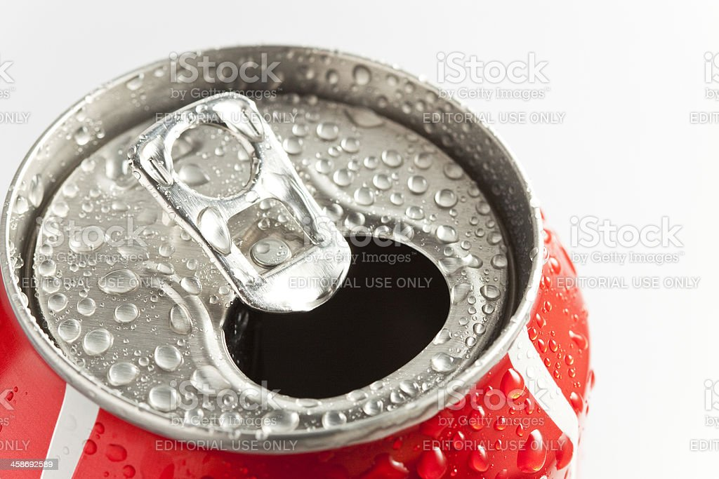 Open Coca-Cola can. Denny, Scotland - March 2, 2011: An image of an open can of Coca-Cola with condensation.  Coca-Cola is a carbonated soft drink which is sold in more than 200 countries worldwide.  It is produced by the Coca-Cola company of Atlanta, Georgia. Can Stock Photo