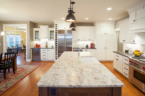 Open Concept Kitchen And Dining Room With Marble Center Island Stock Photo - Download Image Now