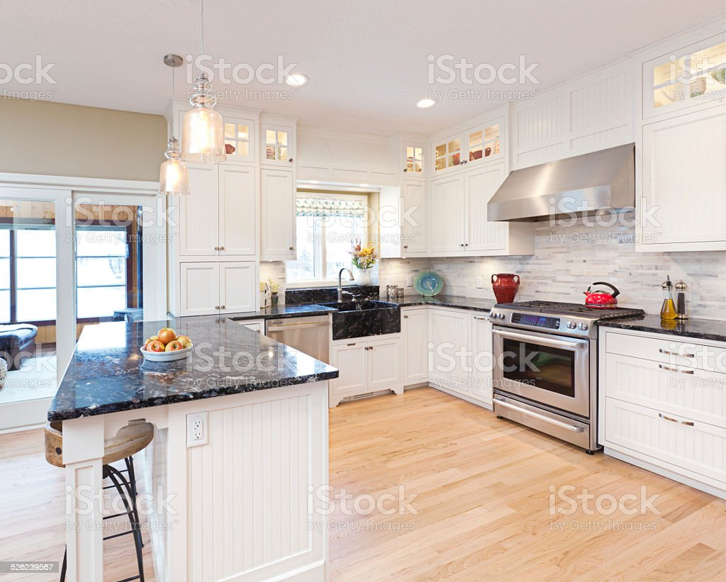 Open Concept Kitchen Design in Contemporary Classic Residential Home Interior stock photo