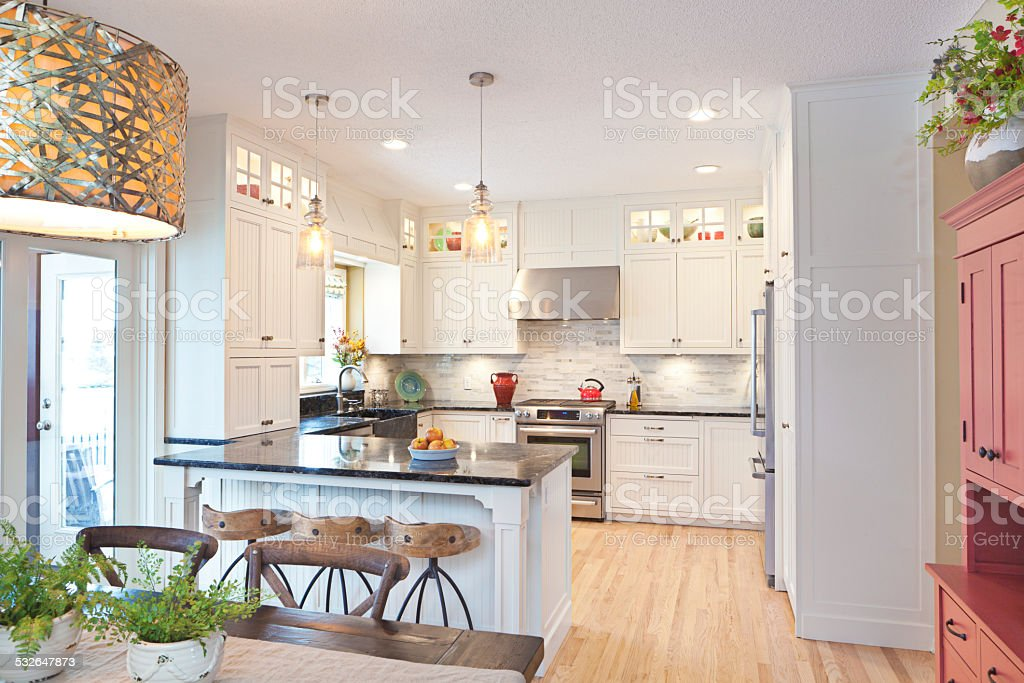 Open Concept Modern Classic Kitchen Design With Dinning Area Stock