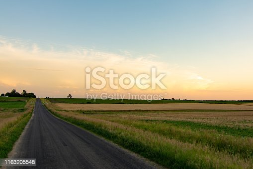 Open country road in rural Illinois as the sun sets.  LaSalle County, Illinois, USA