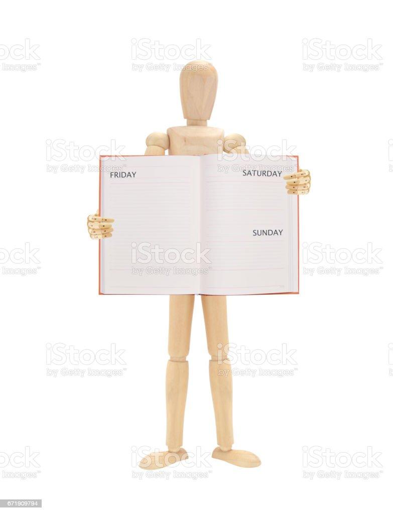 Open Datebook Wood Mannequin stock photo