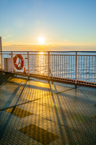 Open deck on a cruise ship and shining sun over the sea - seascape