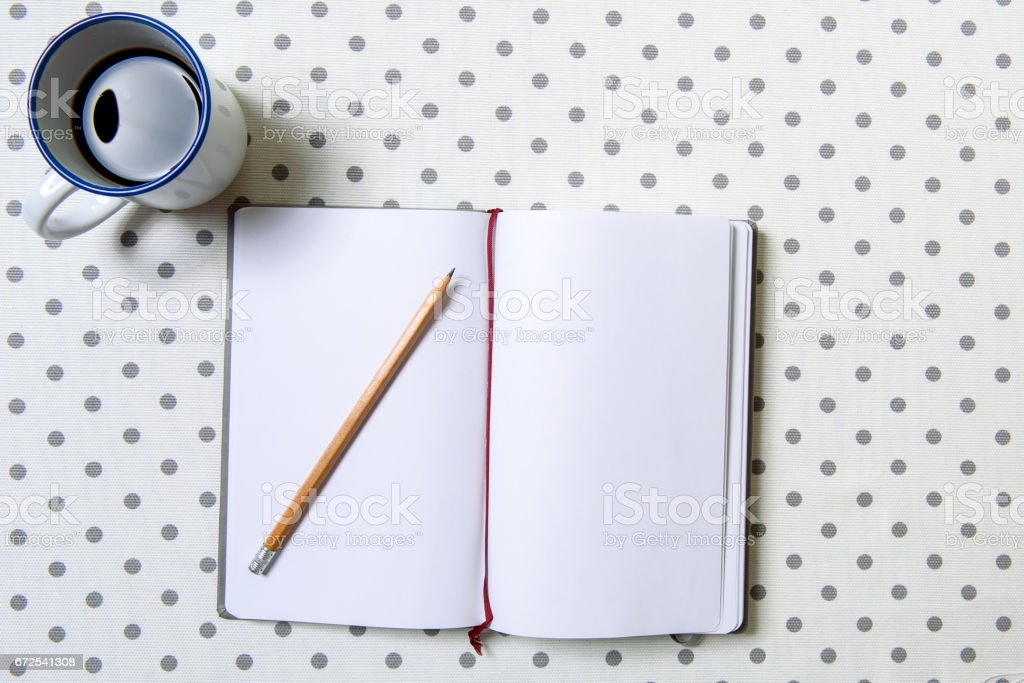 Open diary near small cup stock photo