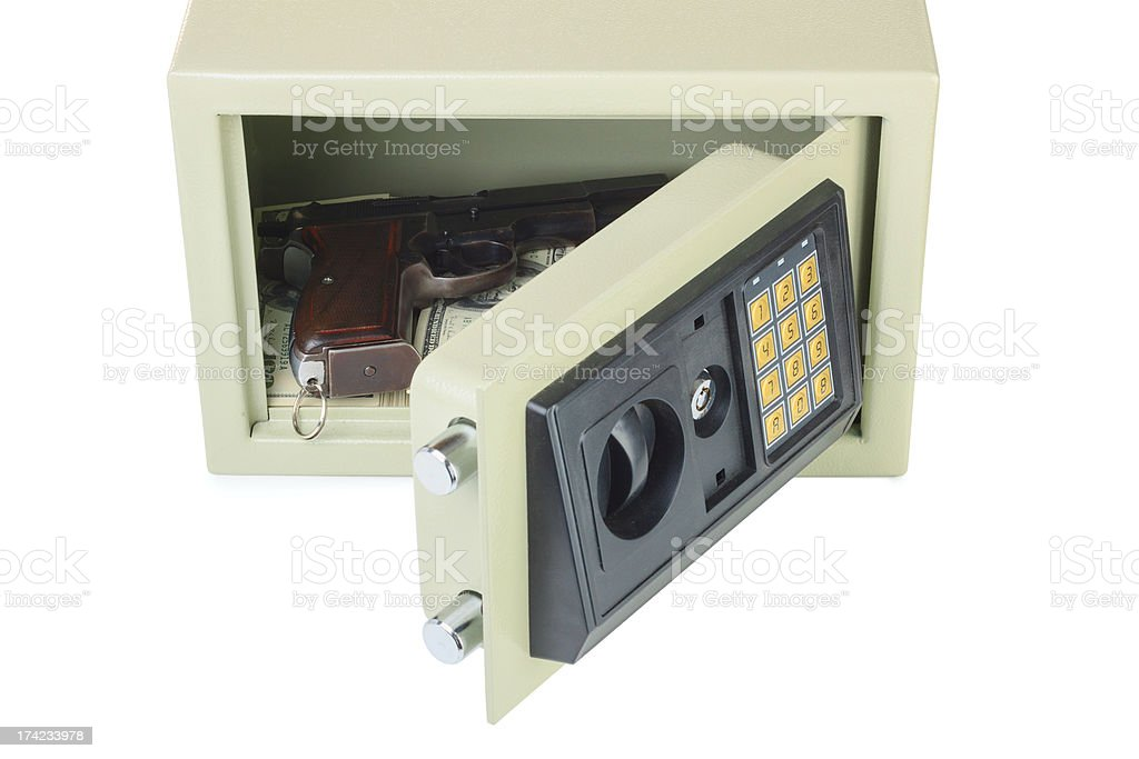 Open digital safe with gun and money stock photo