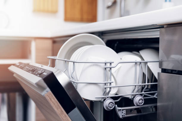 open dishwasher with clean dishes at home kitchen open dishwasher with clean dishes at home kitchen dishwasher stock pictures, royalty-free photos & images