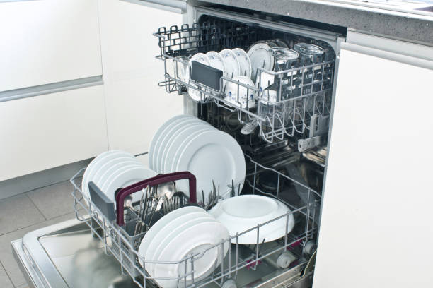 Open dishwasher with clean dishes in the white kitchen Open dishwasher with clean dishes in the white kitchen dishwasher stock pictures, royalty-free photos & images