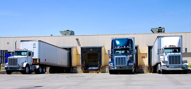 open dock - lorries unloading stock photos and pictures