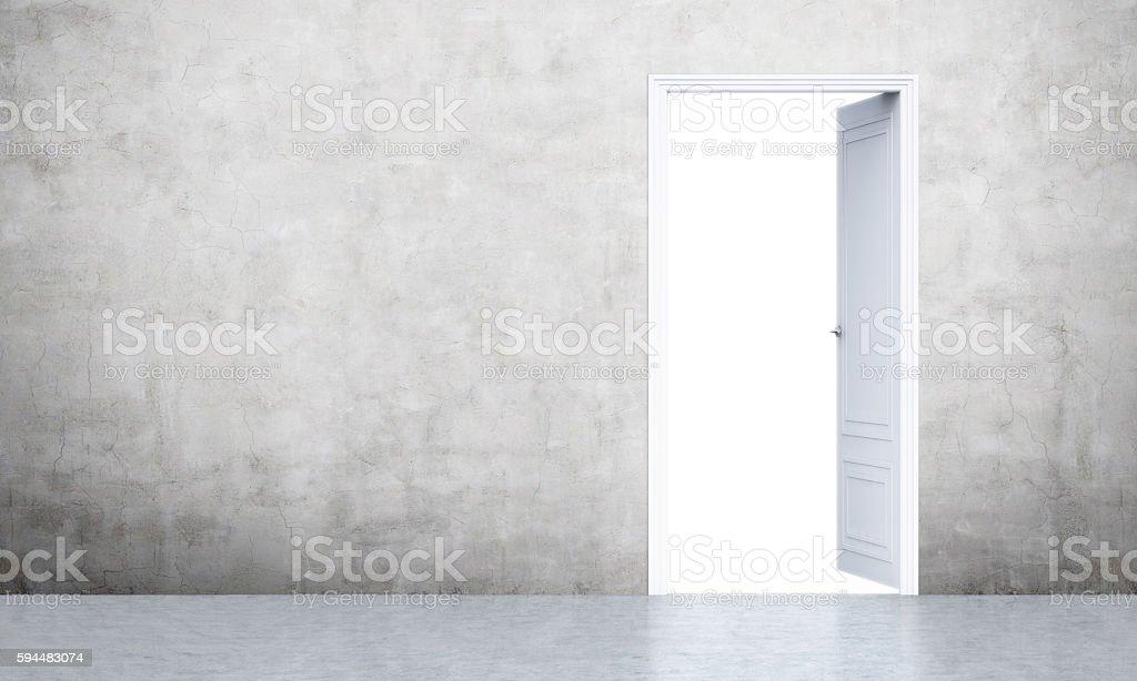 Open door in concrete room stock photo