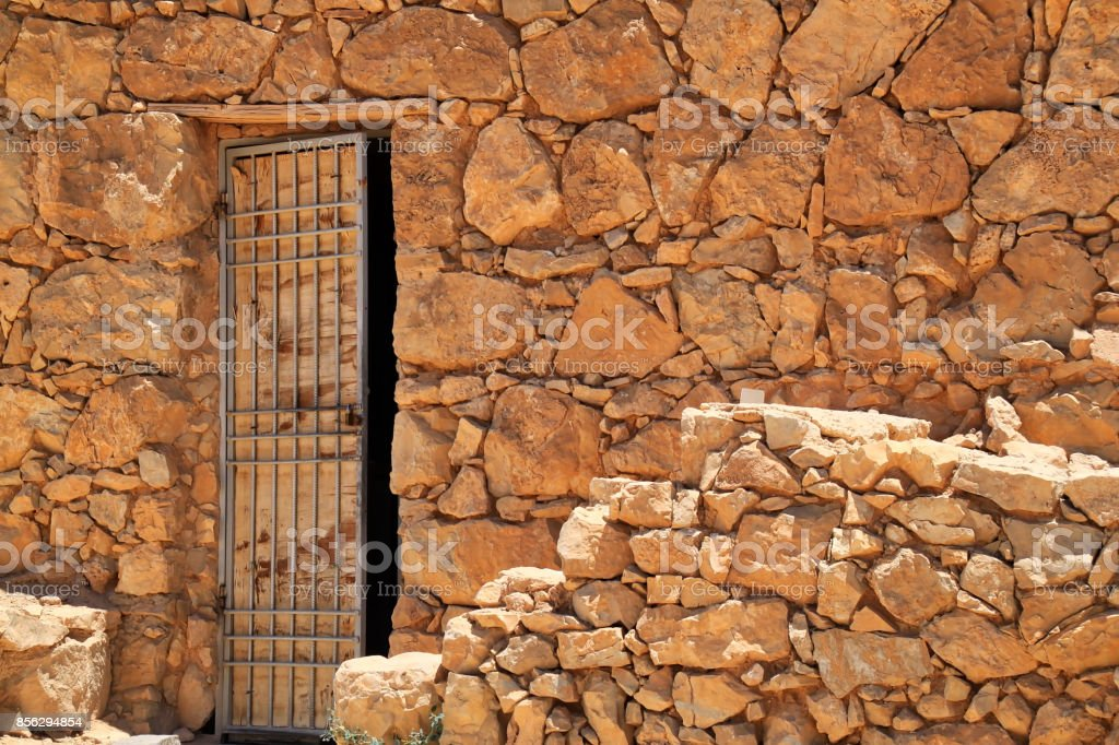 Open door in the rubble of an ancient city wall at the ruins of Masada in Israel stock photo