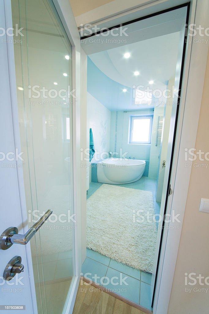 Open door into Bathroom. Modern luxury interior stock photo