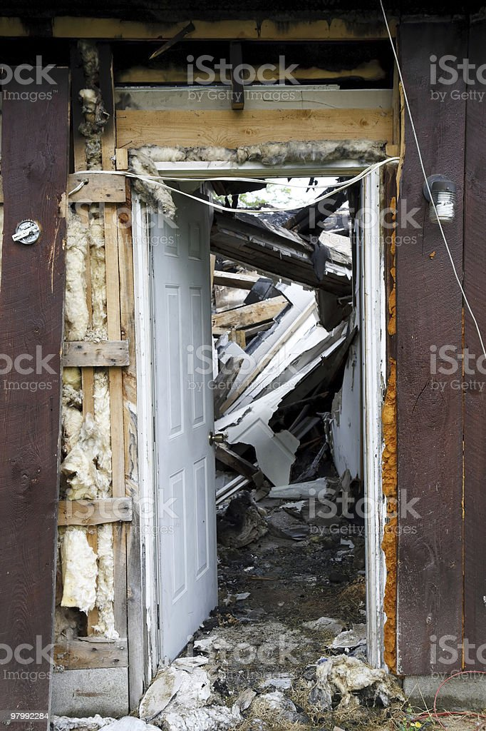 Open door of a house destroyed by fire royalty-free stock photo