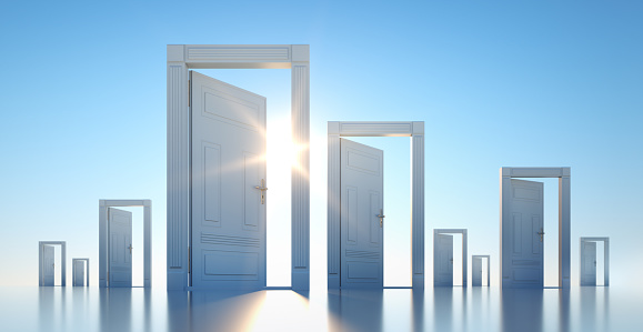 Group of open doors with blue sky and sun