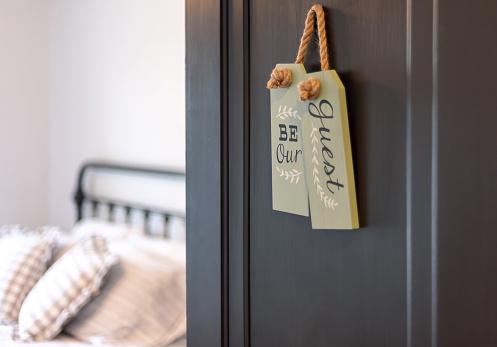 Guest bedroom - open door with sign that says