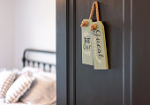 """istock Open door to guest bedroom with a cute sign that says """"Be our guest"""" 1184920990"""