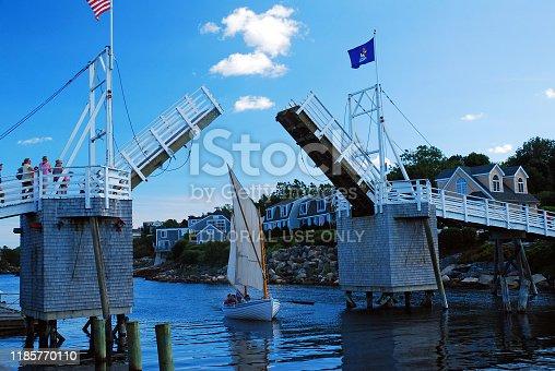 Ogunquit, ME, USA August 12, 2013 An open pedestrian draw bridge in Ogunquit, Maine opens to allow a small sailboat to cruise through