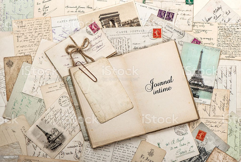 open empty diary book, old letters, french postcards stock photo