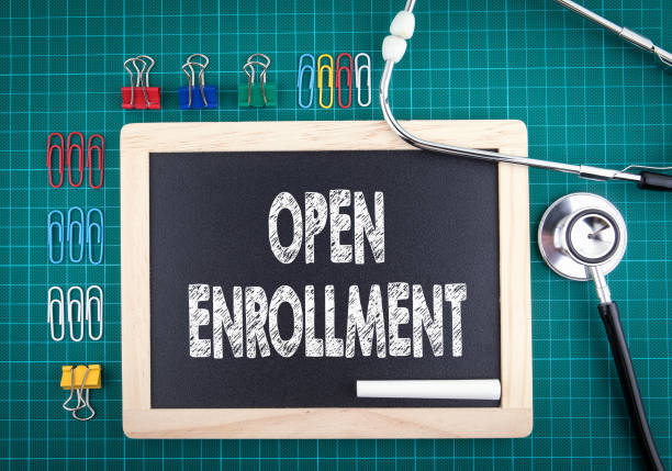 open enrollment concept. medical and health background. work desk with stationery and stethoscope. - open enrollment stock photos and pictures