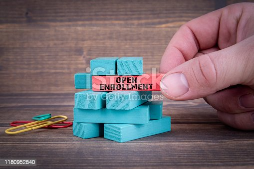 istock Open Enrollment Concept With Colorful Wooden Blocks 1180952840