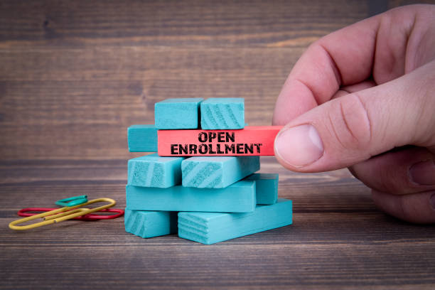 open enrollment concept with colorful wooden blocks - open enrollment stock photos and pictures