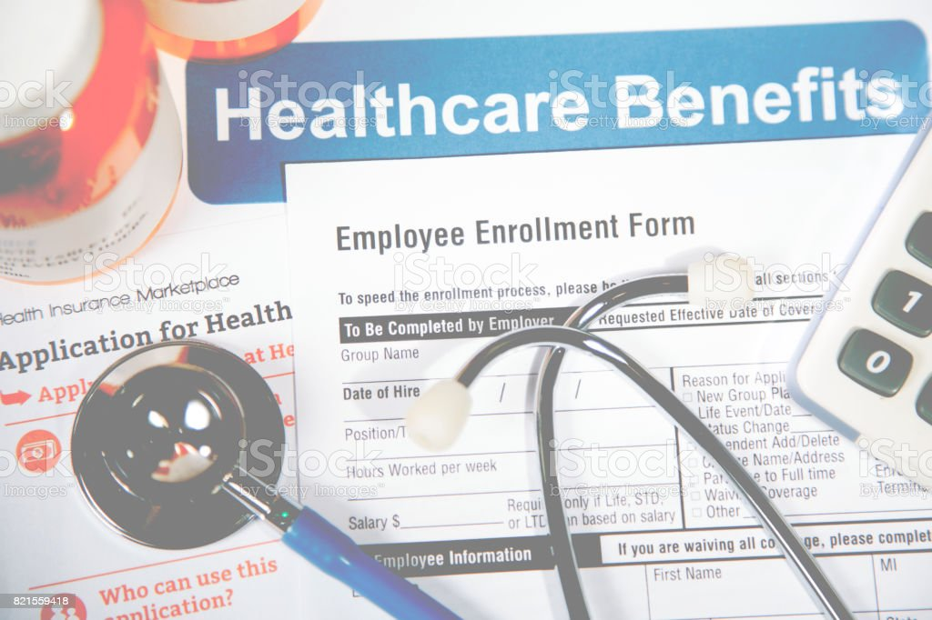 Open enrollment healthcare benefit forms. – zdjęcie