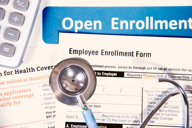 open enrollment healthcare benefit forms. - open enrollment stock photos and pictures