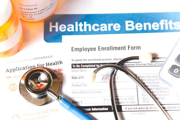 Open enrollment healthcare benefit forms. stock photo