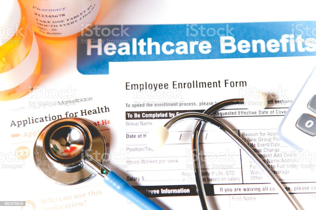 Open enrollment healthcare benefit forms. stock photo