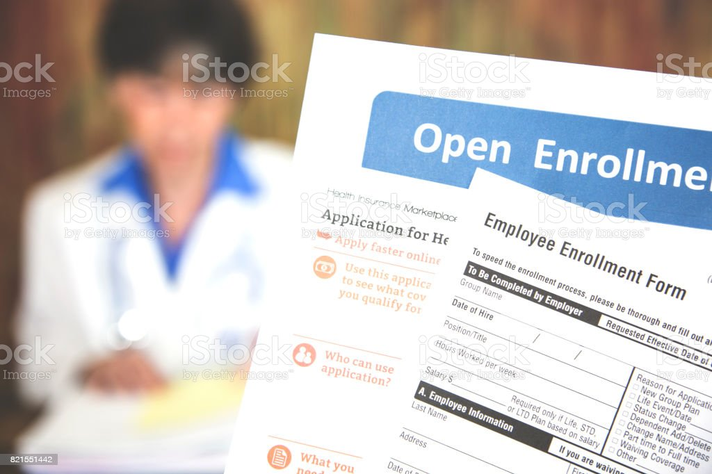Open enrollment healthcare forms and medical doctor.