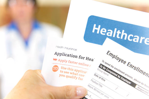 open enrollment healthcare forms and medical doctor. - open enrollment stock photos and pictures