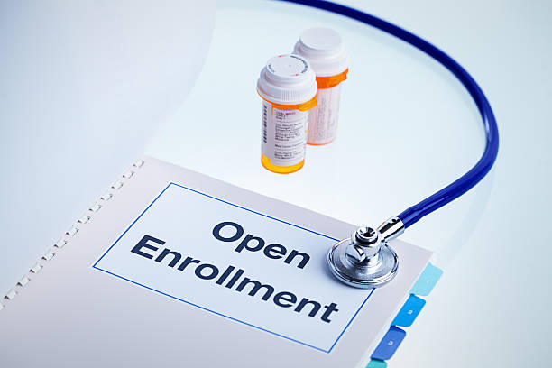 open enrollment insurance obamacare patient protection, affordable care act guide - open enrollment stock photos and pictures