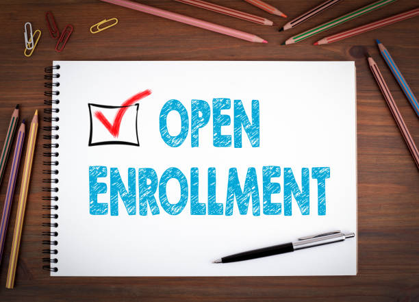 open enrollment. notebooks, pen and colored pencils on a wooden table - open enrollment stock photos and pictures