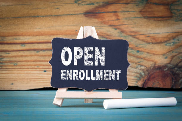 open enrollment. small wooden board with chalk on the table - open enrollment stock photos and pictures