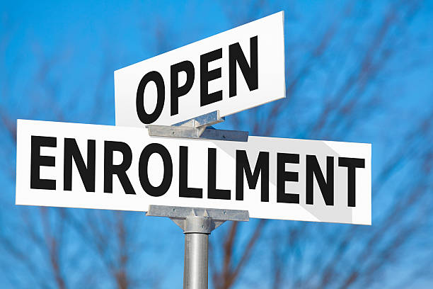 open enrollment street sign - open enrollment stock photos and pictures
