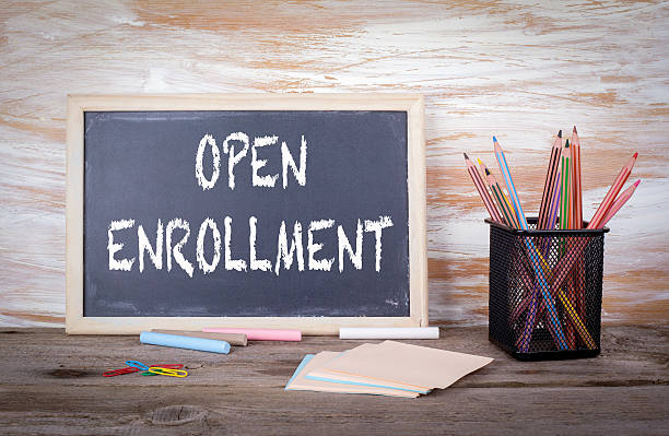 open enrollment text on a blackboard - open enrollment stock photos and pictures