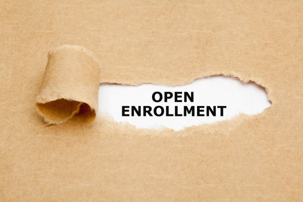 open enrollment torn paper concept - open enrollment stock photos and pictures