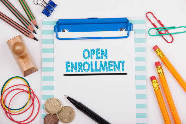 open enrollment. white office desk with stationery - open enrollment stock photos and pictures