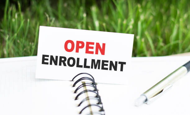 Open Enrollment words on a card in a notebook Open Enrollment words on a card in a notebook enrollment stock pictures, royalty-free photos & images