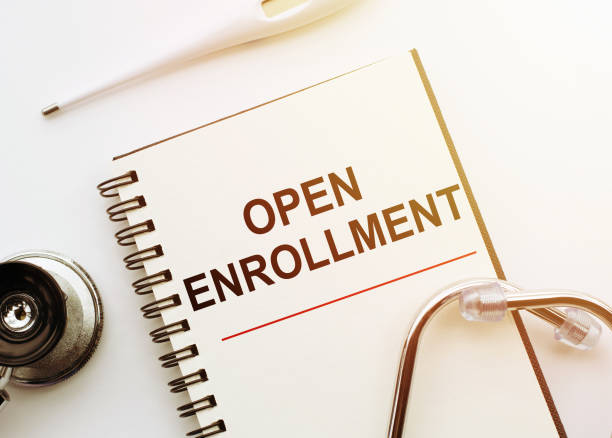Open Enrollment - words written on notebook with stethoscope on white table, Medical Concept Open Enrollment - words written on notebook with stethoscope on white table, Medical Concept enrollment stock pictures, royalty-free photos & images