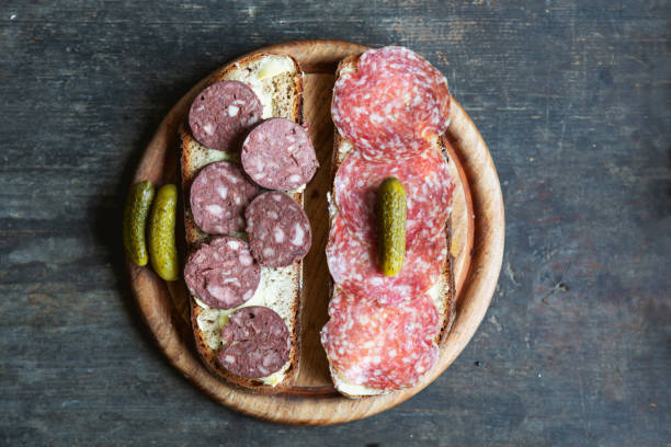 Open face sandwhich  and sausage on wood stock photo