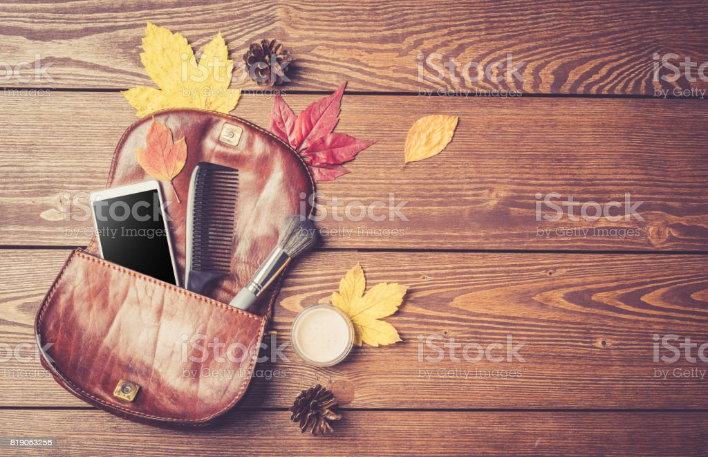Open fashionable women's handbag on wooden background stock photo