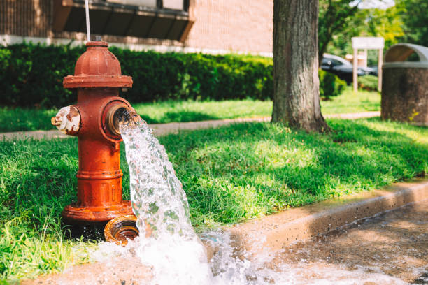 Open Fire Hydrant Open hydrant spewing water flushing water stock pictures, royalty-free photos & images