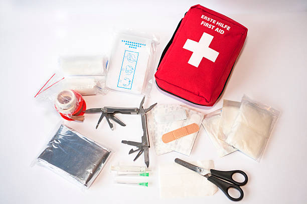 open first aid kit - first aid stock photos and pictures
