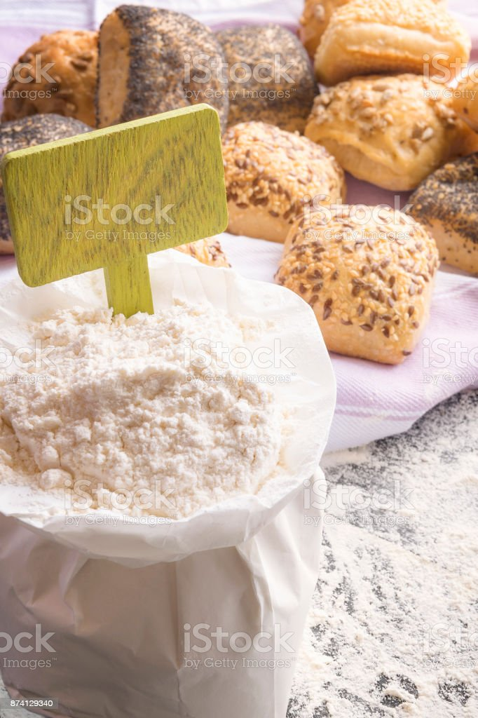 Open flour bag and a banner stock photo