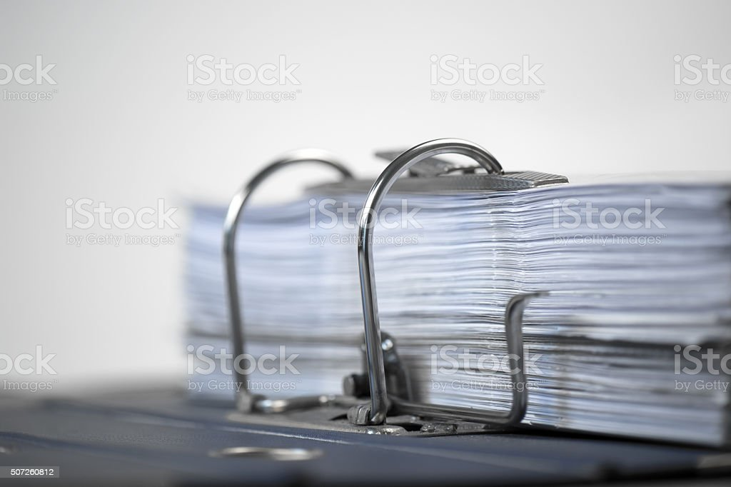 Open folder with documents filed on white background stock photo