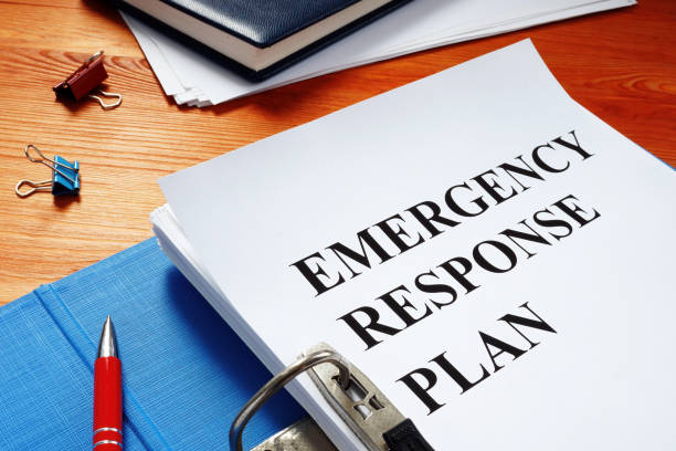 Open folder with Emergency response plan. Open folder with Emergency response plan. accidents and disasters stock pictures, royalty-free photos & images